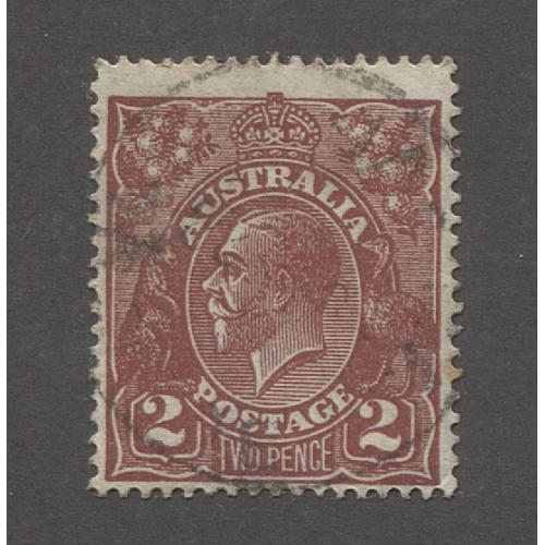 (UU1517) AUSTRALIA · 1927: lightly used 2d red-brown KGV defin (SM Wmk · perf.14) w/variety DAMAGED UPPER FRAME AT LEFT AND SHADING BELOW ACSC 98(16)r · see description · c.v. AU$180 (2 images)