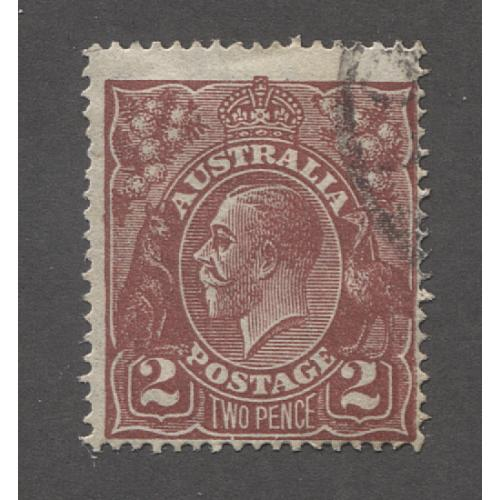(UU1526) AUSTRALIA · 1927: used 2d red-brown KGV defin (SM Wmk · perf.14) with variety FLAW on 2 and LOWER FRAME BROKEN UNDER W ACSC 98(16)q · excellent condition · c.v. AU$180